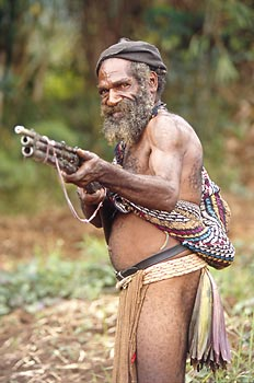 Huli warrior with home-made gun