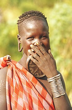 A shy Mursi girl with a decorated lip plate